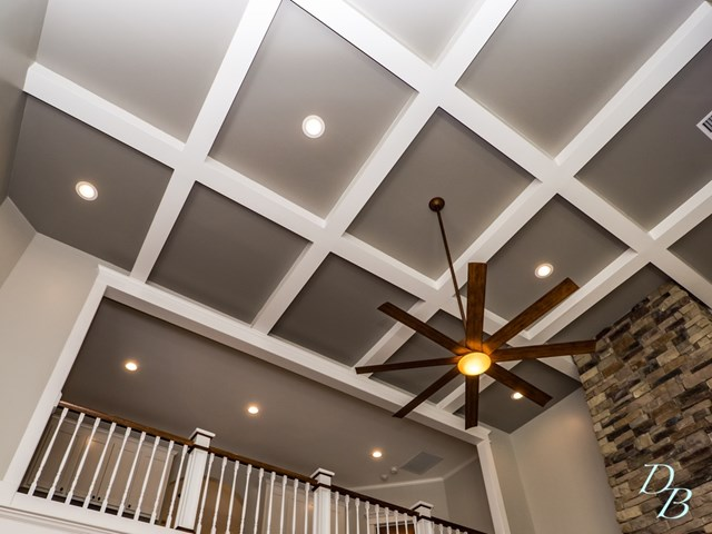 Stately coffered ceilings with recessed lighting.
